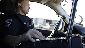 Officer hands on computer vehicle-1 (1).