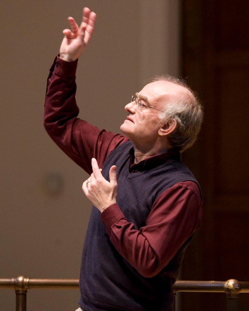 Photograph of John Rutter, conducting music