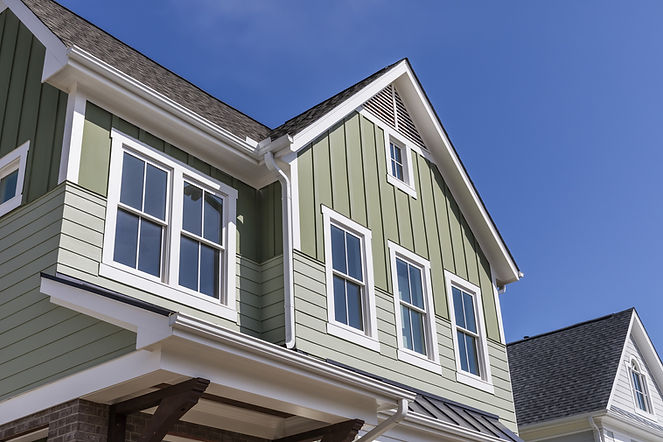 Green Home With White Trim