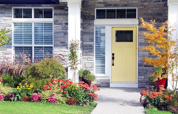 Brick Home With A yellow Door