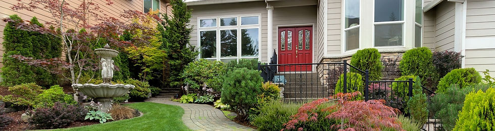 Home With A Large Front Yard Garden & Bird Bath