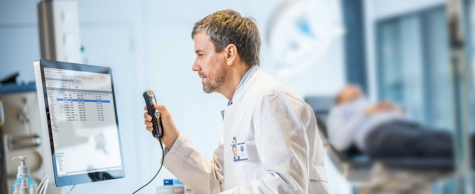 A doctor dictating with a speech mic into an EHR