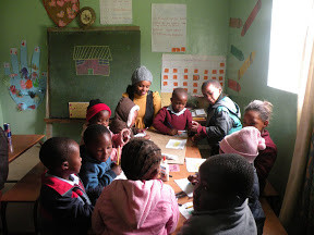 Maureen Mungai meets with preschoolers to introduced character education into academic learning.