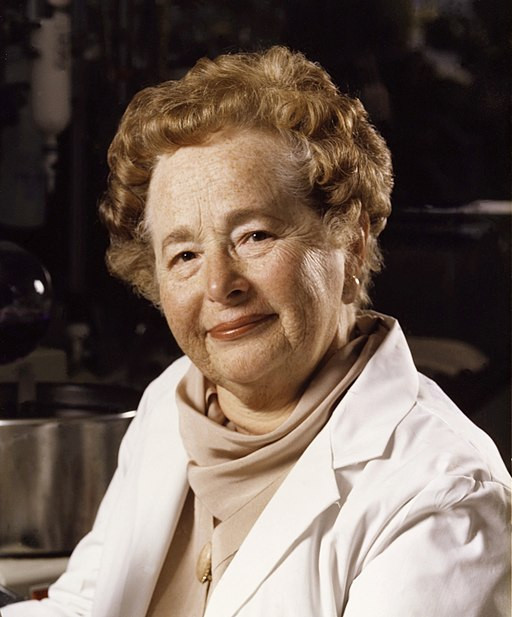 A portrait of scientist Gertrude Elion wearing a laboratory coat.
