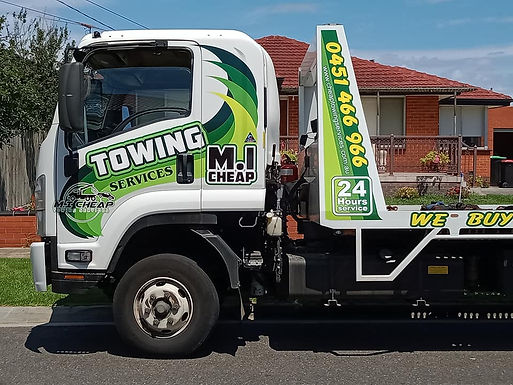 Towing-Truck-Sign-M.I-Cheap