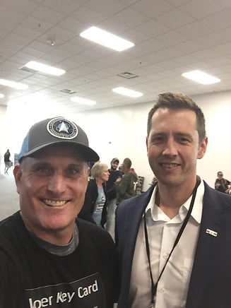 Me and Seth Keshel at Reawaken America Colorado Springs - web.png