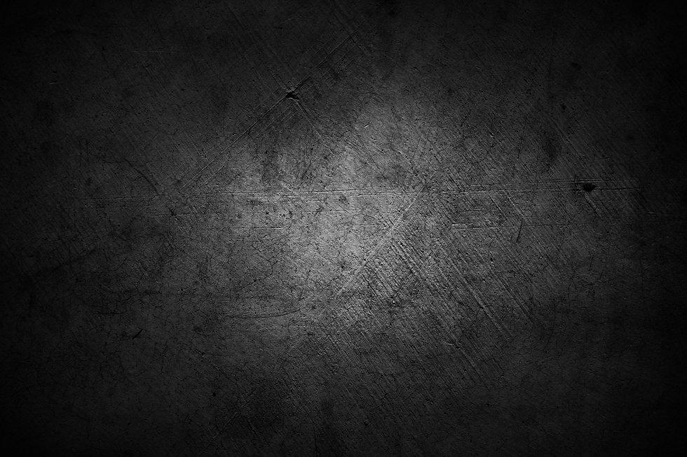 Dark grunge textured wall closeup.jpg