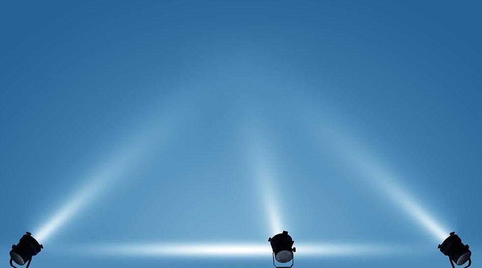 Spotlights illuminate empty stage blue b