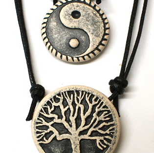 ethnic pendants on a neclace  διεθνή σύμβολα σε κολιέ