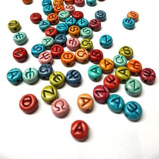 write your name with the Alphabet multicoloured, engraved beads - offer a unique present  γράψε τ'όνομά σου με πολύχρωμες κεραμικές χάντρες-ένα μοναδικό δώρο