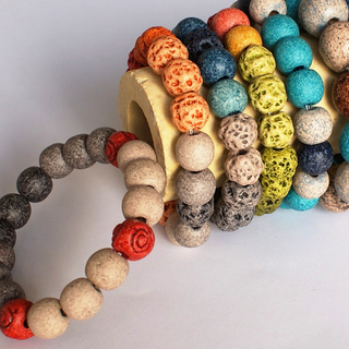 stylish bracelets with red spiral or 'lava' beads  βραχιόλια με στιλ, κόκκινη χάντρα με σπιράλ ή 'λάβα'