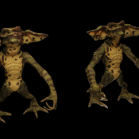 Retopologized gremlin (left, 300 polys) alongside the photoscanned gremlin on the right (300,000 polys).