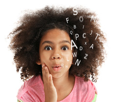 African-American little girl with book and alphabet letters on white background. Speech therapy conc
