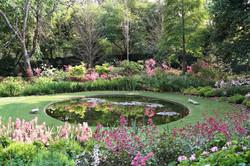 Garden of St Christopher, reflection pond in Spring