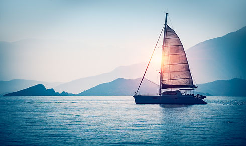 Sailboat in the sea in the evening sunli