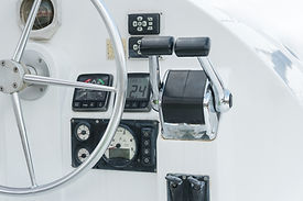 sailing yacht control panel and wheel.jp