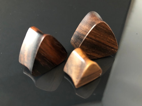 Organic triangle shaped wooden plugs