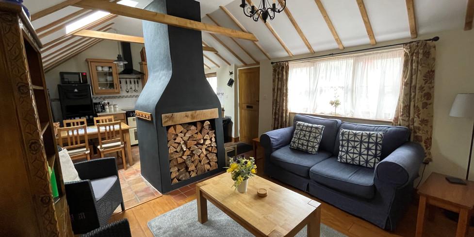 Corner Cottage: Sitting room leading to kitchen