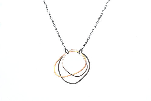 Silver and Gold Pendant Uneven Circles