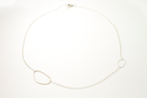 Short silver necklace with irregular circles