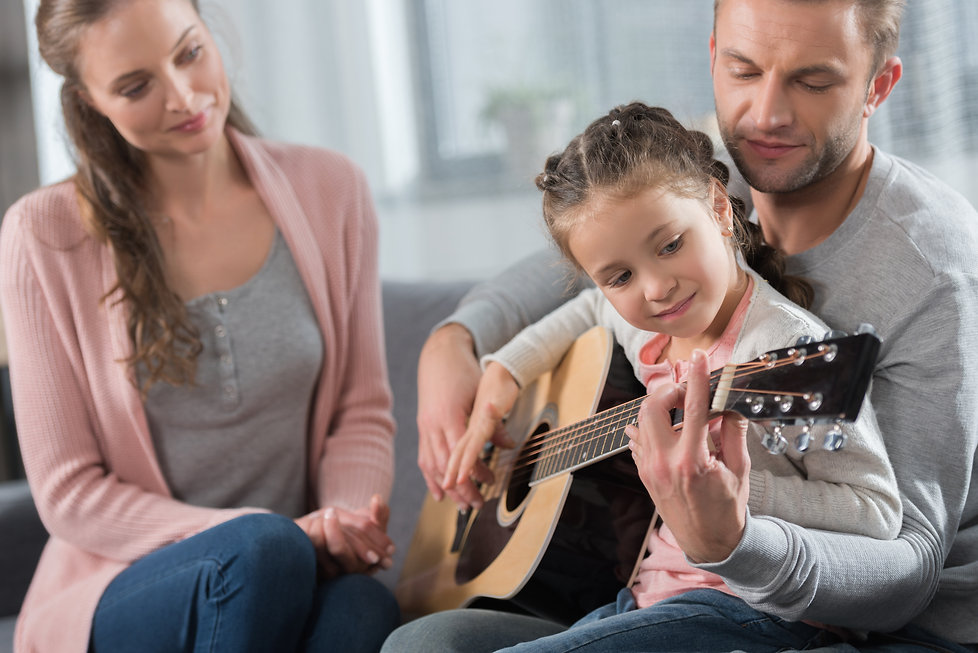 girl with parents playing guitar.jpg