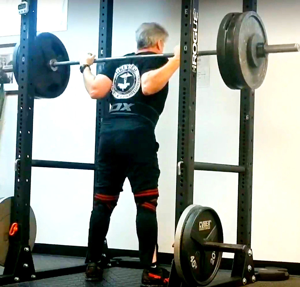 """The proper """"grip"""" for the low bar back squat."""