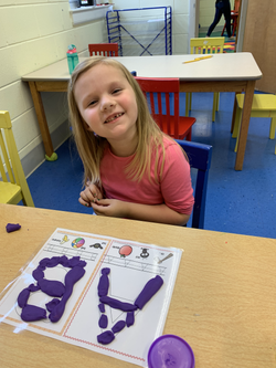 Practicing letters with Play doh in the 4's