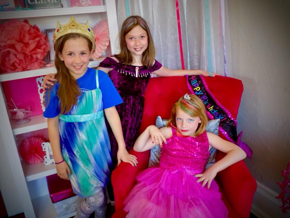 Three Girls pose from the birthday throne after dress up!