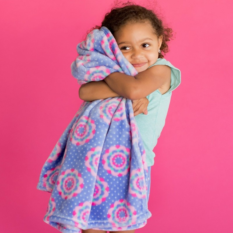 Little girl holds a blanket which could be used to wrap a gift