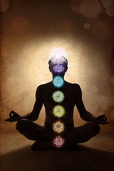 Yoga man in lotus pose with chakra symbo