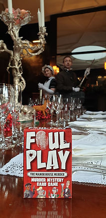 Foul Play card game with servants in background