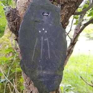 Awen symbol scratched on a piece of slate, found near Nant Ewyn, Pennant Melangell