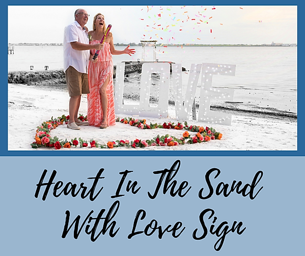 Heart In The Sand With Our Love Sign.png