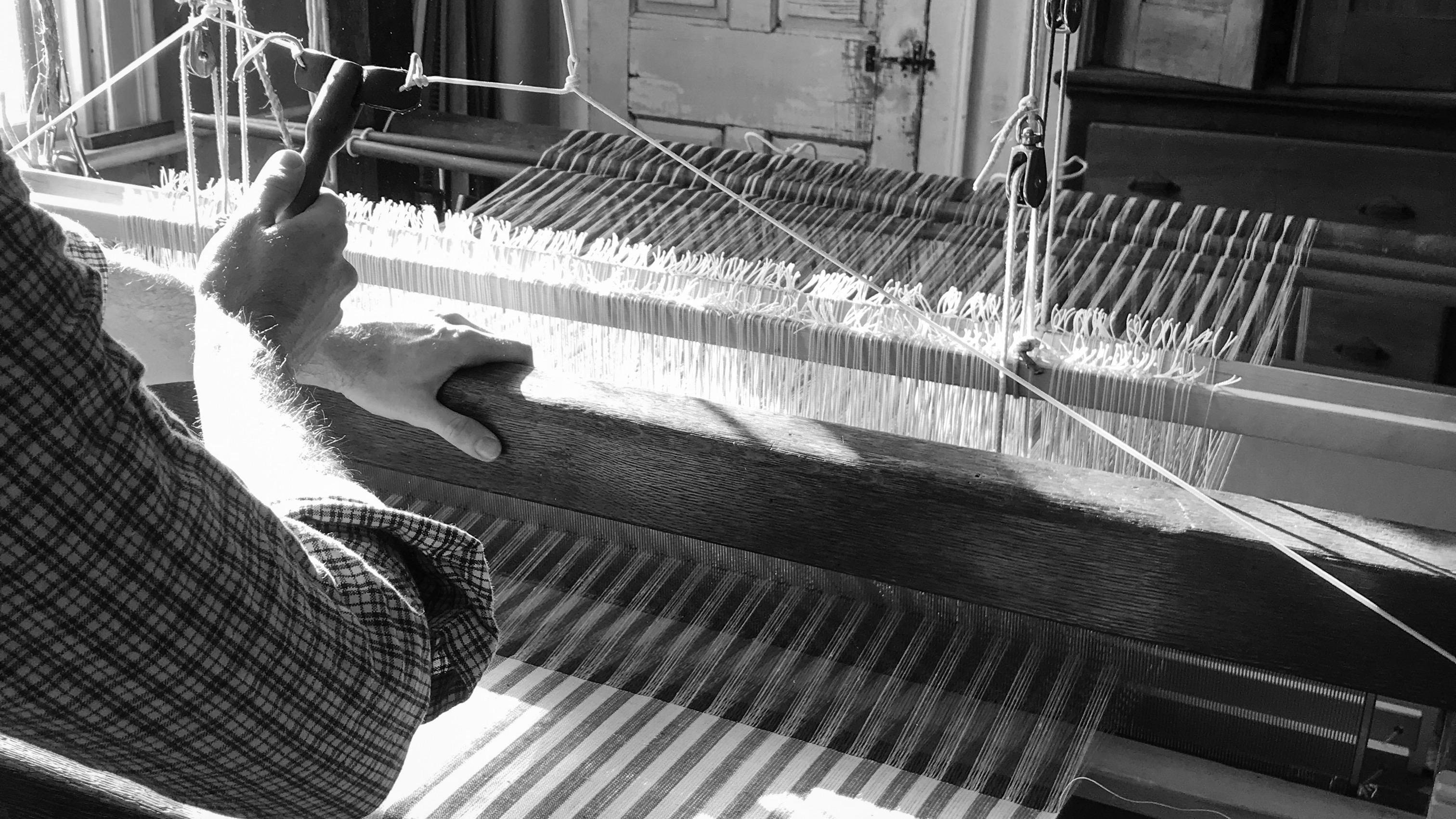 Justin Squizzero weaving linen barn loom