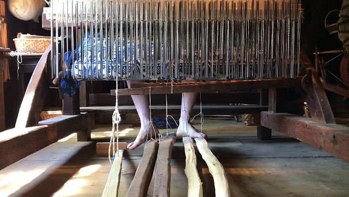 Lingos and treadles on a handloom jacquard weaving figured coverlets.