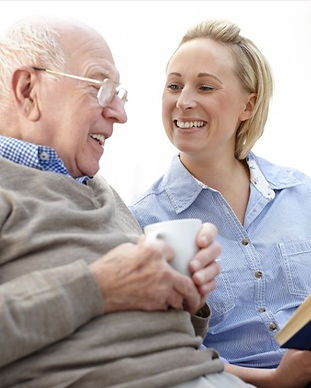 Carer-with-elderly-man-and-book-resized-