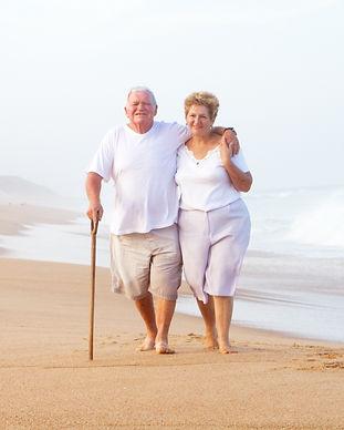 elderly couple walking on beach_edited_e