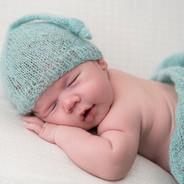 Nouveau-né avec ensemble en laine turquoise