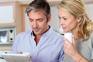 Couple-looking-at-our-website-on-an-iPad