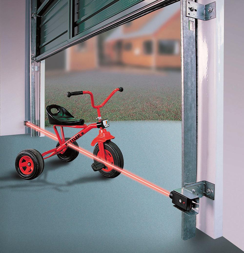 garage door safety sensor purpose