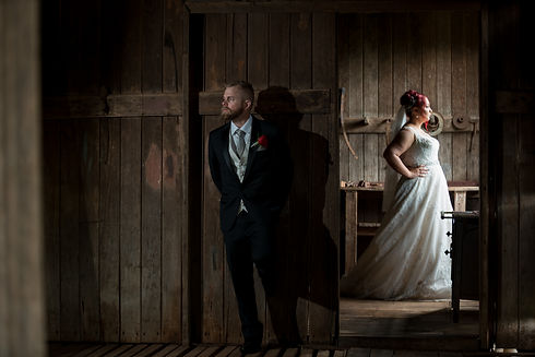 Photo of groom and bride standing looking in opposite direction | Alegna Wedding Photography