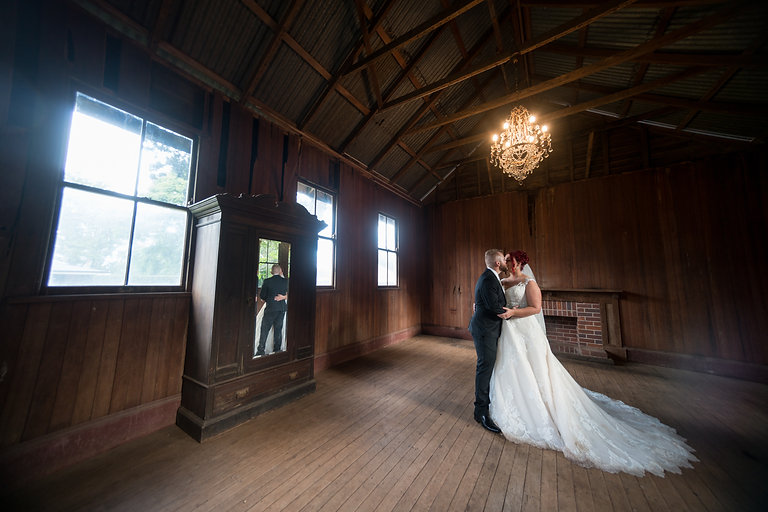 Groom and Bride kissing in the barn | Wedding Photography