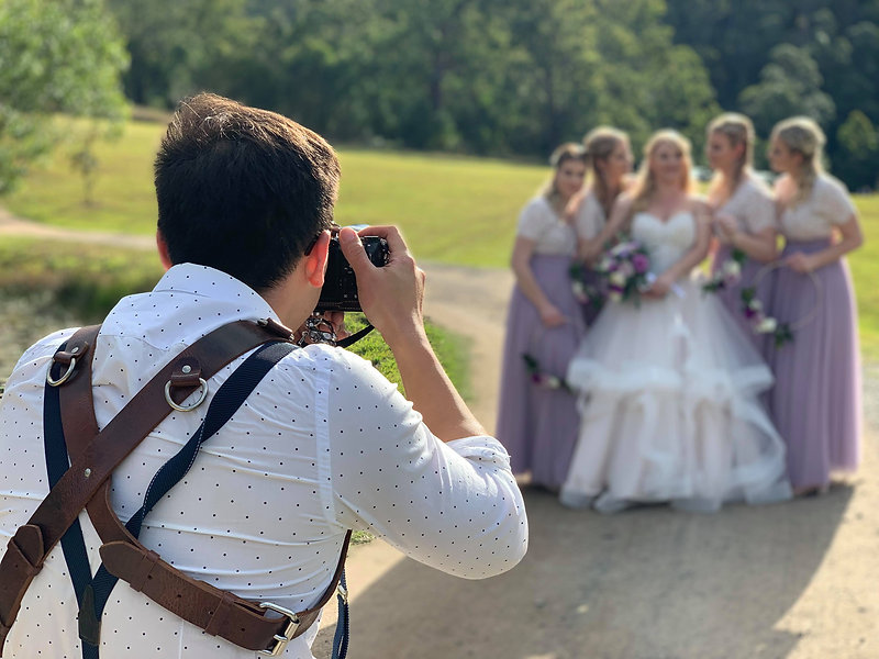 Wedding photographer taking pictures of the bride and bridesmaids
