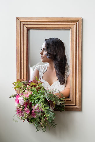 Photo of bride in a wooden portrait frame