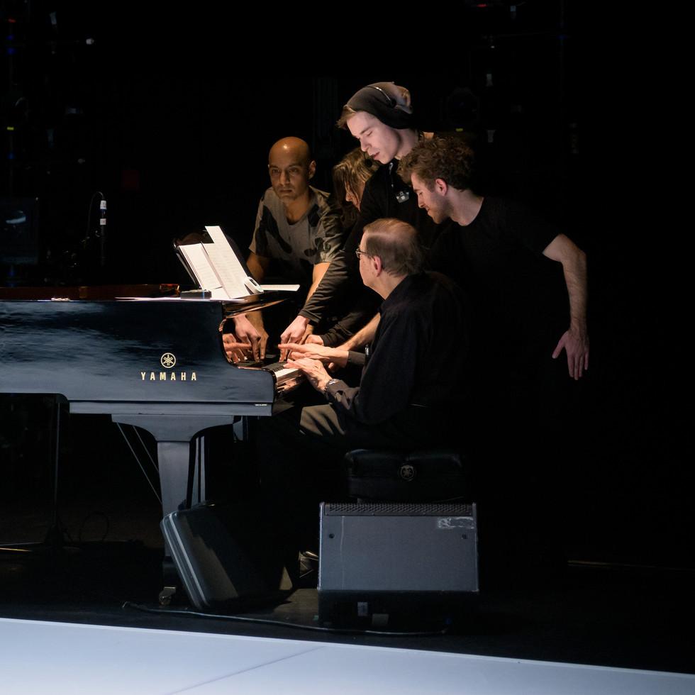Musician Joseph Kubera with performers