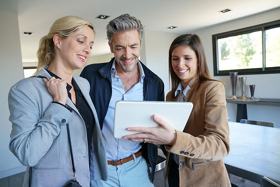 Couple visiting home with real-estate agent.jpg