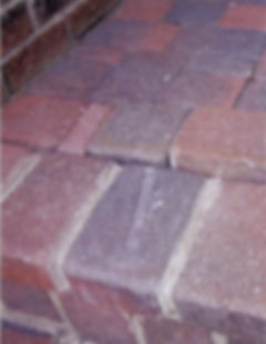 porch paver steps needing repair