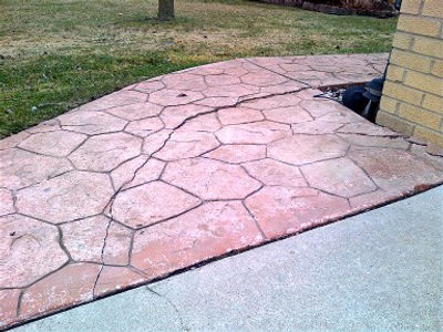 Cracked stamped concrete can't be repaired like brick pavers can