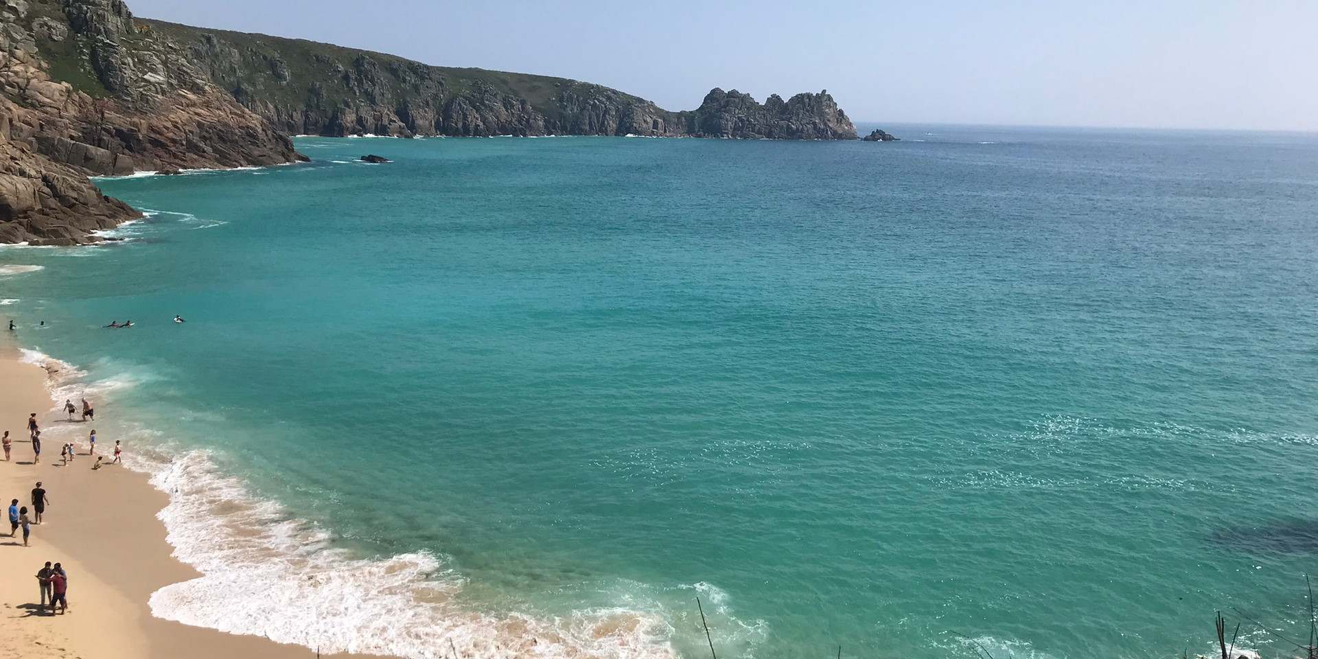 Porthcurno beach (10 mins walk) over towards Pedny and the Logan Rock