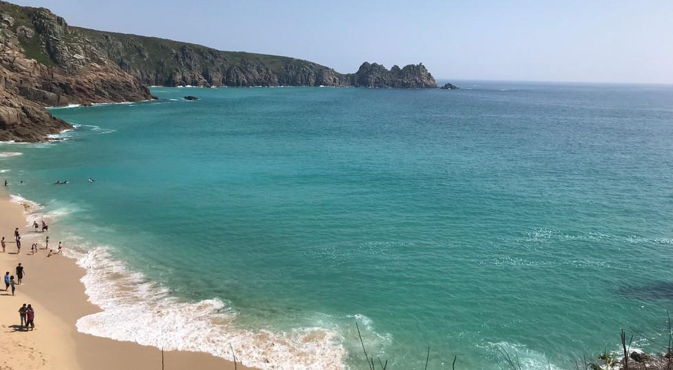 Porthcurno beach (10 mins walk) over towards Pedny and the Logan Rock